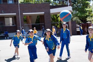 St Therese Catholic Primary School Lakemba - students playing basketball at school yard